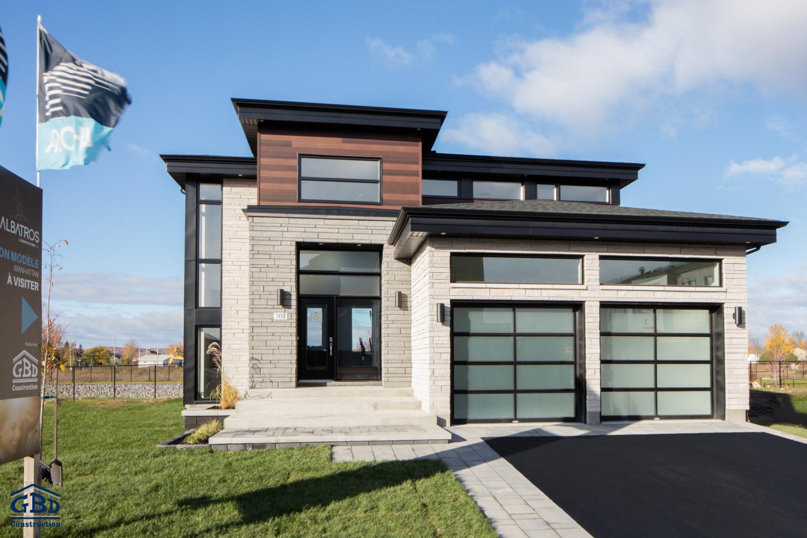 Maison neuve rive nord manhattan ext 03 for Construction maison neuve rive nord